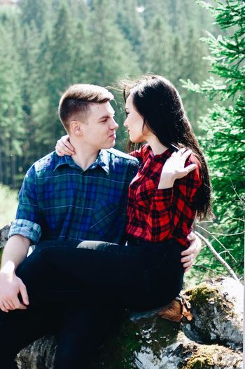Loving young couple romancing in forest
