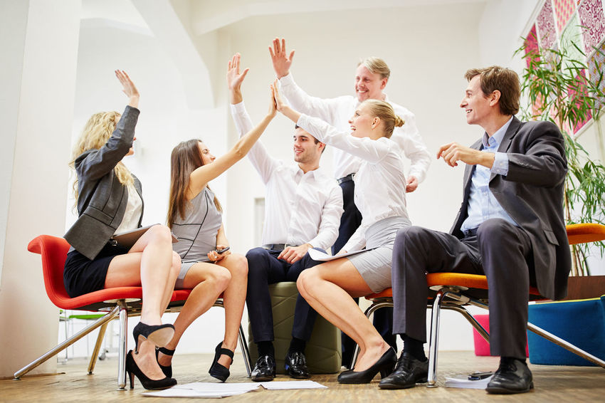 group of people sitting on chair Adult Arms Raised Business Business People Businessman Businesswoman Casual Clothing Celebration Chair Cheering Cooperation Coworker Emotion Employee Enthusiasm Full Length Give Group Group Of People Hand Hands Happy High Five Human Arm Indoors  Males  Man Many Men Motivation Network Office Partnership Party People Real People Seat Sitting Staff Success Successful Team Teamwork Togetherness Victory Win Winner Woman Women Young Adult Young Women