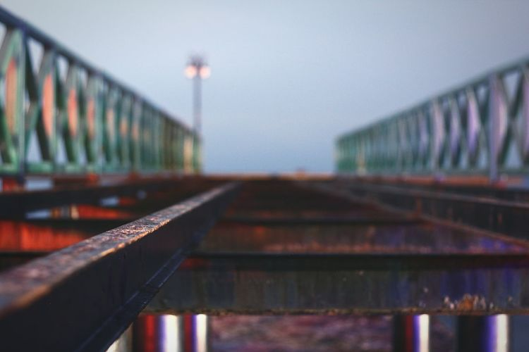 Close-up of footbridge against clear sky