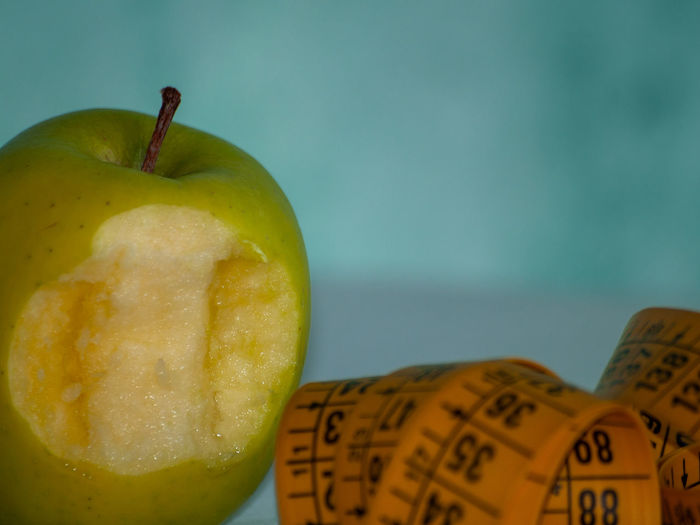Apple Diet Diet & Fitness Food And Drink Healthcare Measuring Measuring Tape Obesity Slim Apple Apple - Fruit Body Positive  Close-up Concept Conceptual Dieting Fat Focus On Foreground Food Food And Drink Freshness Fruit Granny Smith Apple Green Color Group Of Objects Healthy Healthy Eating Healthy Lifestyle Indoors  Lifestyles No People Organic Ripe Sacrifice Slim Down Still Life Studio Shot Table Vitamin Wellbeing Yellow