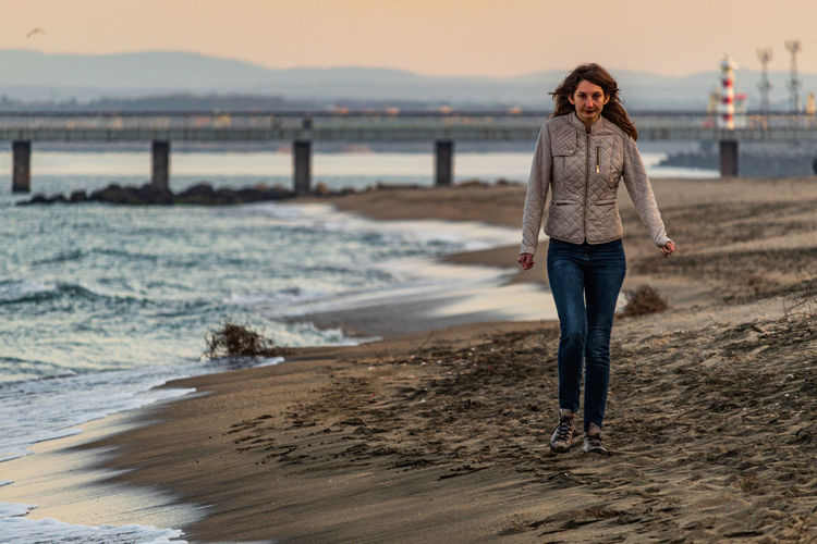 Walking by the waves Black Sea Travel Photography Nature Walking Adult Sea By The Sea Beach Outside Woman Woman Walking Down The Beach Outdoors Woman Walking Bokeh Landscape Jeans People person Waves Young Adult Bulgaria Warm Clothes Walk Warm Long Hair Travel Beaches Lighthouse Beach Walk Sand Seaside Adult Woman Human Nature Photography Burgas  One Person Water Real People Land Full Length Casual Clothing Standing Lifestyles Leisure Activity Sky Focus On Foreground Front View Beauty In Nature Beautiful Woman The Portraitist - 2019 EyeEm Awards The Street Photographer - 2019 EyeEm Awards