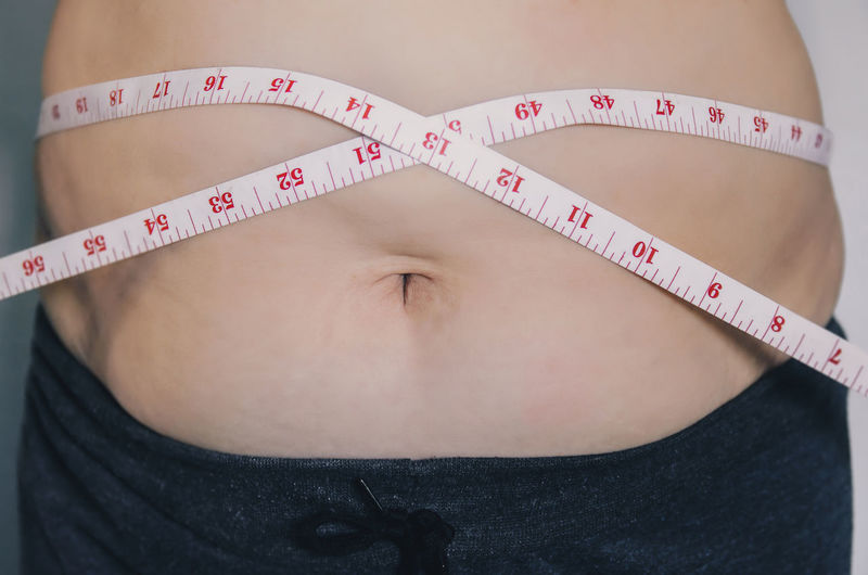 Close-up of human body and fat body, Fat body part of paunch or belly, Overweight of people or excess weight with measuring tape. Body & Fitness Diet Diet & Fitness Heavy Measuring Measuring Tape Obesity Overweighted Belly Body Conscious Body Part Dieting Fat Father Human Human Body Part Measurement Measuring Overweight person Tape Tape Measure Weight Weights