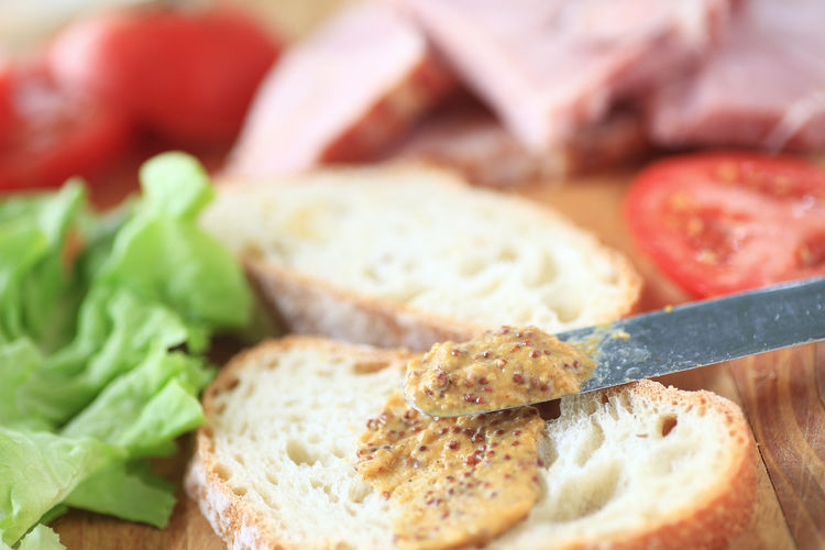 Bread Close-up Food Food Preparation Freshness Grainy Mustard Ham Homemade Indoors  Indoors  Lettuce Lunch Making Sandwich Meal Natural Light Nobody Selective Focus Snack Spreader Textures Tomatoes Vegetables