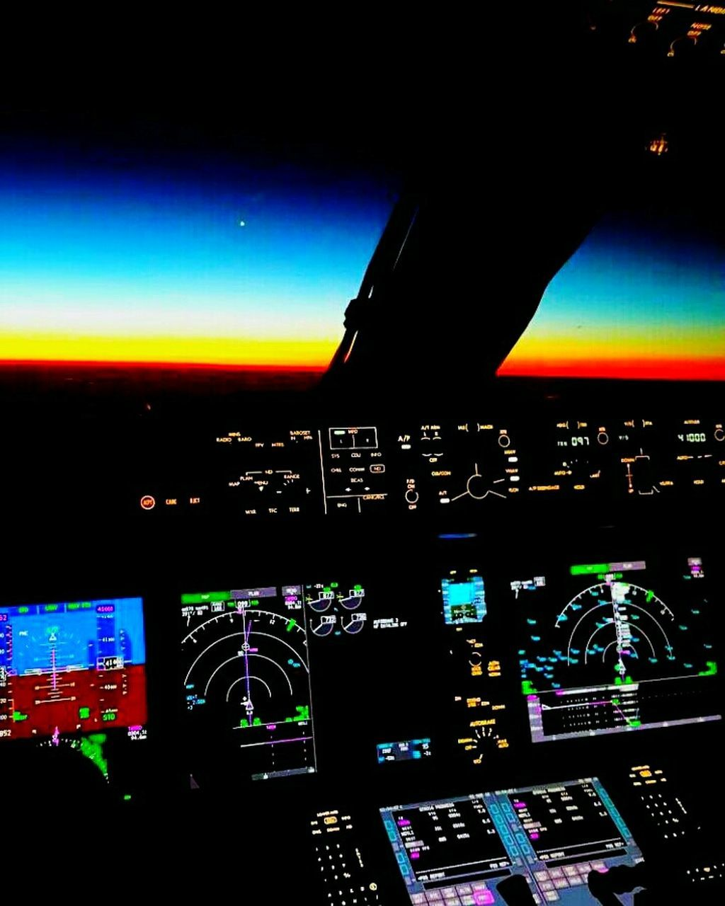 airplane, control panel, air vehicle, cockpit, transportation, aerospace industry, dashboard, mode of transport, technology, gauge, commercial airplane, multi colored, illuminated, indoors, complexity, airport runway, night, no people, close-up, sky