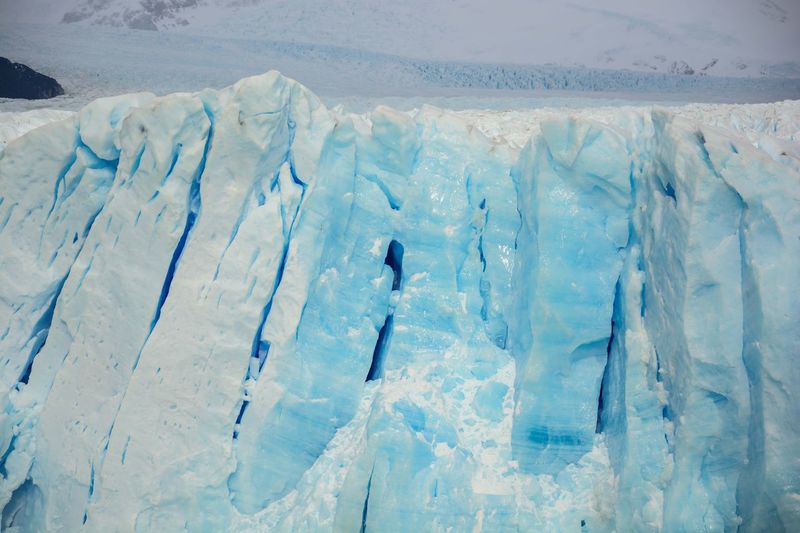 Perito Moreno Glacier, El Calafate, Santa Cruz, Argentina. Adventure Beauty In Nature Cold Temperature Day Extreme Sports Frozen Horizontal Landscape Leisure Activity Mountain Nature Outdoors Scenics Ski Holiday Snow Snowboarding Snowcapped Mountain Sport Tranquility Vacations Warm Clothing Weather White Color Winter Winter Sport