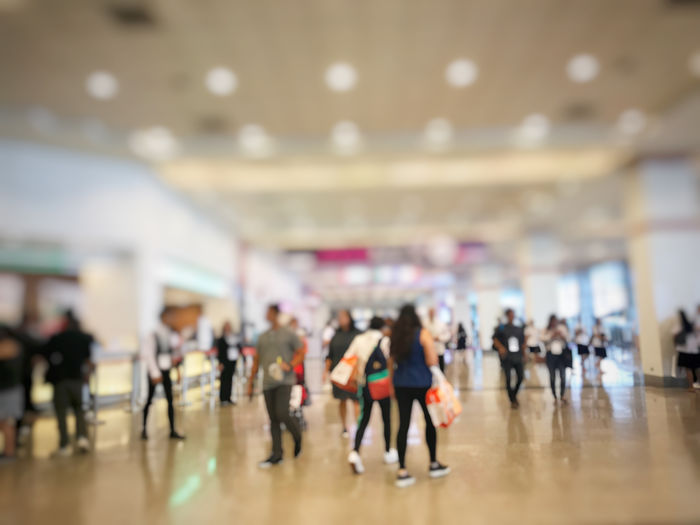 Abstract blur people with bag is shopping on black friday international technology exhibition indoor hall with perspective to the center.This is good for economic and investment using marketing Cyber Monday E-commerce Event Perspective Sale Supermarket Architecture Bare Tree Black Friday Blurred Background Business Background Buying Crowd Exhibition Group Of People Indoors  Interior Large Group Of People Mall Mega Sale Purchase Shopping Bag Store Walking Women