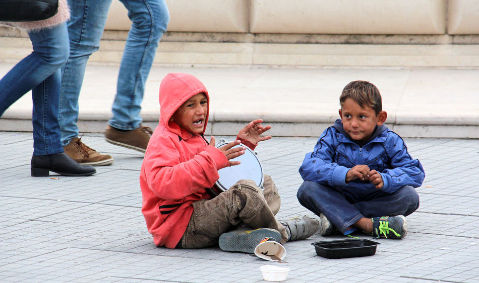 beggar boys in skopje , macedonia.. oct. 26.2016 Autumn Beggar Beggar Boys Begging Boy Boys Singing Boys Sittin Cold Darbuka Day Editorial  Gypsy Macedonia Macedonia Skopje Money Music Oh Outdoors People Percussion Instrument Playing Roma People Skopje Social Issues Two