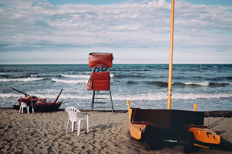 A kind of order Baywatch Sea In Winter Winter Beach Italian Beach Romagna Sea Beach Sand Horizon Over Water Water Sky Shore Nature Beauty In Nature Chair No People Scenics Nautical Vessel Outdoors Day Tranquility Wave Cloud - Sky Colour Your Horizn