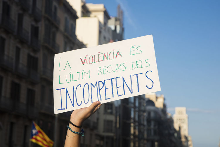 """Barcelona, Spain - October 3, 2017. Demonstrators bearing placards during protests for independence in Barcelona, Catalonia, Spain. On that banner is said: """" Violence is the last resort of incompetents"""" Barcelona Catalonia Catalonia Is Not Spain Democracy Freedom Independence Independencia Politics Protest Protest Signs Protests Rights Challenge Crowd Democratic Independent  March Political Politics And Government Protesters Protesting Protestor Protestors Riot Riots"""