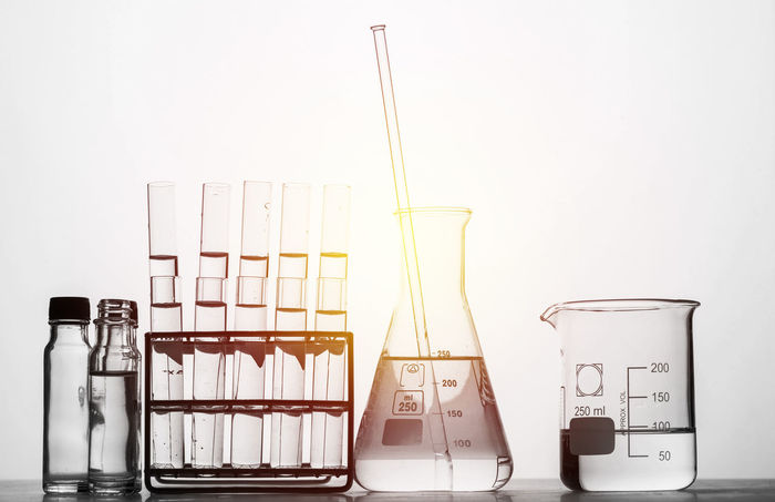 science background Bottle Close-up Day Flask Healthcare And Medicine Indoors  Laboratory Liqueur Liquid Medical Research No People Research Science Scientific Experiment Studio Shot Test Tube Test Tube Rack White Background