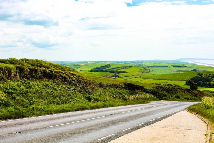 Jurassic Coast Green Color Nature Road Scenics Beauty In Nature Sky Landscape Travel Beginnerphotographer Lightroom Outdoor Photography Grass Tranquil Scene Tranquility Non-urban Scene Idyllic No People Field Day Outdoors The Way Forward Growth Tree Mountain