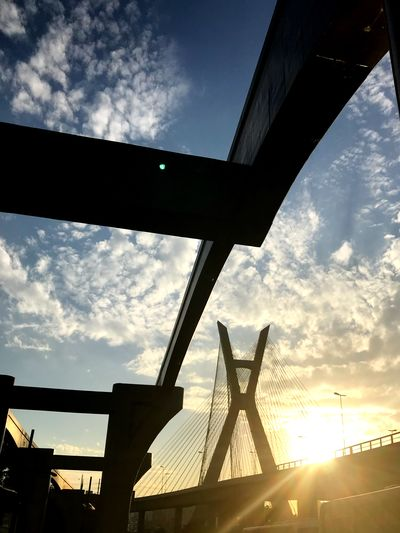Sky Cloud - Sky Architecture Low Angle View Built Structure Nature The Architect - 2018 EyeEm Awards Silhouette Sunlight Sunset Building Exterior No People Lens Flare Outdoors Metal Bridge Sunbeam Summer Road Tripping