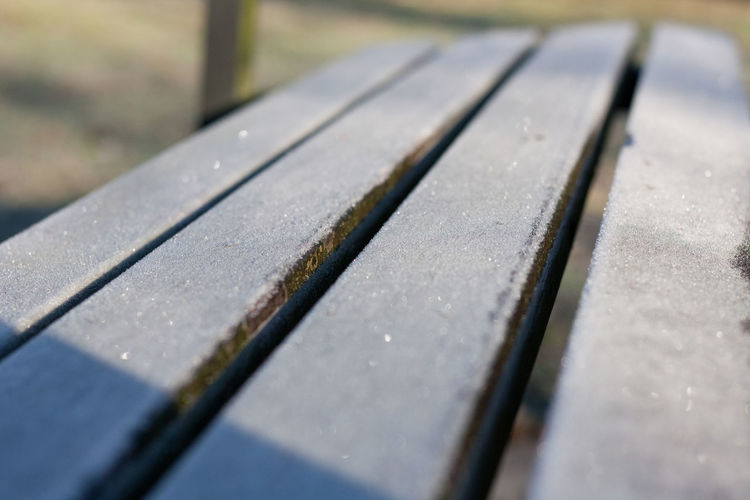 Icy morning Hoarfrost Selective Focus No People Close-up Day Wood - Material Pattern Outdoors Nature High Angle View In A Row Bench Metal Full Frame Textured  Backgrounds Sunlight Seat Focus On Foreground Surface Level Icy Ice Frozen Copy Space Glittering