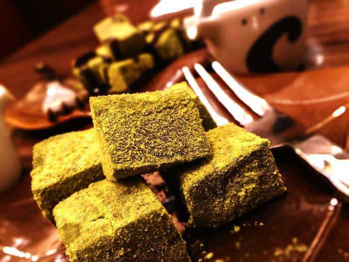 Square sweets garnished with green tea and chocolate. Close-up Gold Gold Colored Golden Metal Ore Mine Buddha Ruby Wat Pho Platinum Gilded Gold Chain  Bling Bling Diamond - Gemstone Jewelry Bauble Gemstone  Precious Gem Ingot Diamond Ring