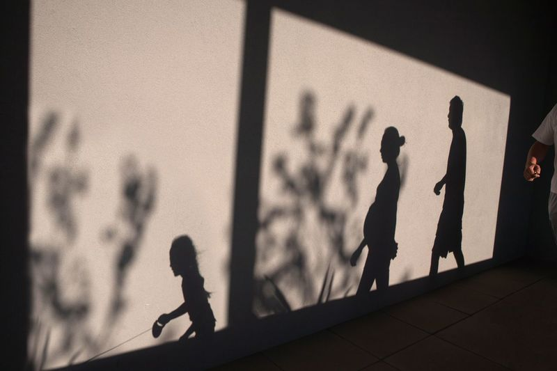 Silhouettes of Family with Pregnant Mother EyeEmBestPics EyeEmbestshots EyeNewHere Family Woman Adult Child Childhood Day Figurine  Men Outdoors People Playing Pregnant Real People Silhouette Summer