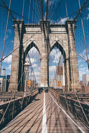 criss-crossing the brooklyn bridge Architecture Blue Brick Bridge Bridges Brooklyn Brooklyn Bridge / New York Building Exterior Built Structure City Connection Eye4photography  EyeEm Best Shots International Landmark Long New York New York City Showcase March Sky The Way Forward Vanishing Point