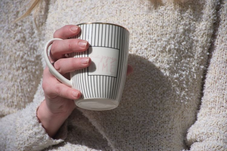 Human Hand Hand One Person Human Body Part Food And Drink Drink Holding Refreshment Cup Mug Adult Lifestyles Coffee Real People Hot Drink Coffee Cup Coffee - Drink Body Part Finger Drinking Sweater White Woman
