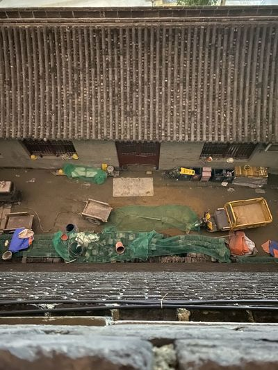 High angle view of people working on railroad track