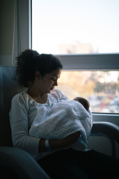 Newborn Mother Mother & Daughter Clinic Hospital Maternity Mommy Mommylife Love Positive Emotion Family Family With One Child Family Matters Breastfeeding Baby Newborn Baby Babyhood Babygirl Sitting Window Contemplation Looking Relaxation