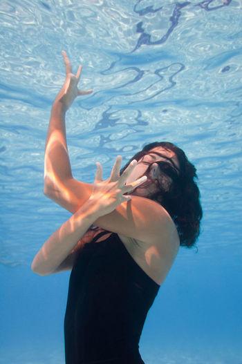 Female model swimming in pool