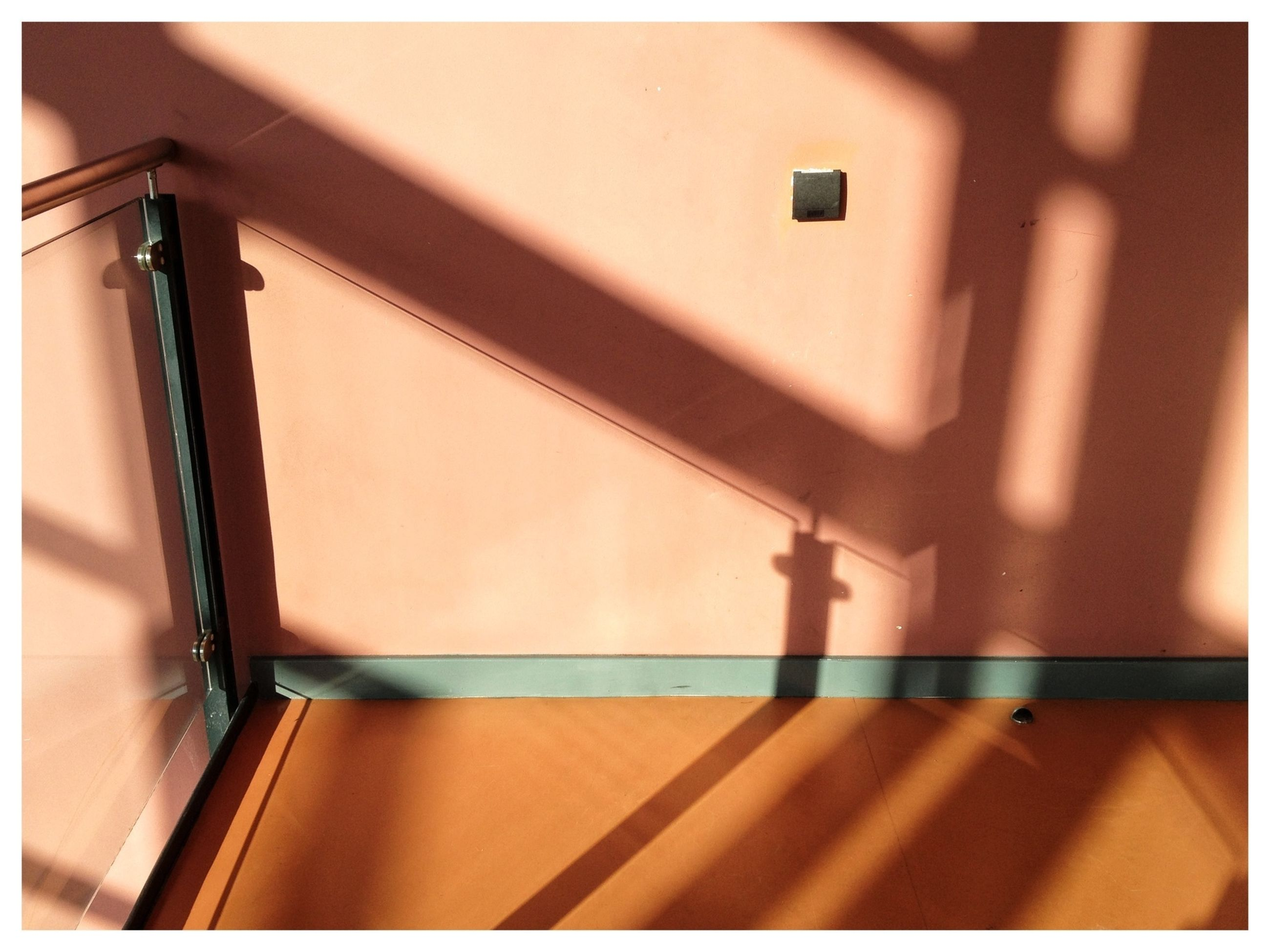 indoors, railing, architecture, built structure, auto post production filter, transfer print, steps, steps and staircases, staircase, no people, window, day, multi colored, wall - building feature, pattern, low angle view, sunlight, red, wall, shadow