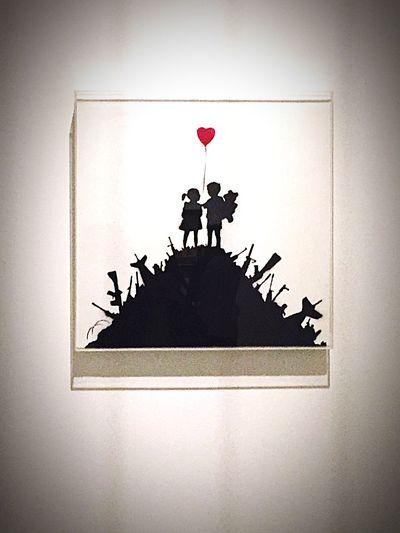 kids on guns Banksy
