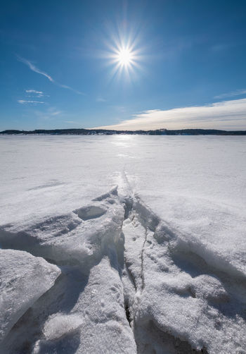 Scenic winter landscape with bright sunlight and sun at winter day in lake Finland Sky Tranquility Beauty In Nature Tranquil Scene Nature Scenics - Nature Sunlight Cloud - Sky No People Winter Day Sun Environment Cold Temperature Lens Flare Bright Outdoors Landscape Finland Daylight Beauty In Nature Bright Ice Frost Frozen