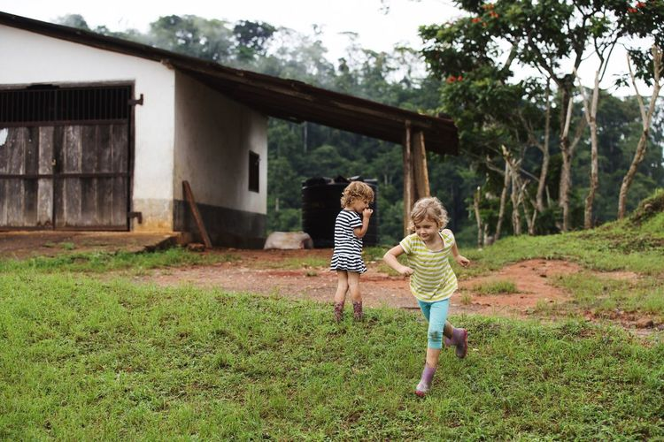 Happy kids Happy Children Kids Fun Sisters Tanzania Child Childhood Full Length Plant Grass Offspring Females Two People Hair Togetherness Casual Clothing Girls Nature Happiness Sister