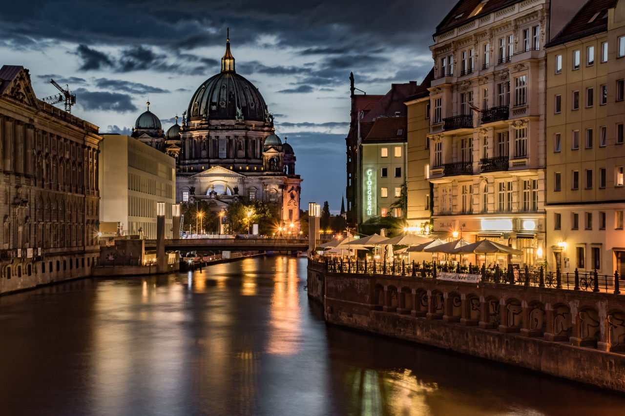 architecture, building exterior, built structure, sky, religion, dome, place of worship, water, spirituality, travel destinations, illuminated, night, cloud - sky, waterfront, outdoors, no people, city