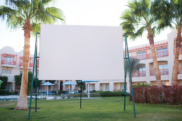Apartments Billboard Blank Blocks Cinema Commercial Copy Space Display Entertainment Holiday Lawn Modern MOVIE Outdoor Screen Showing Tropical
