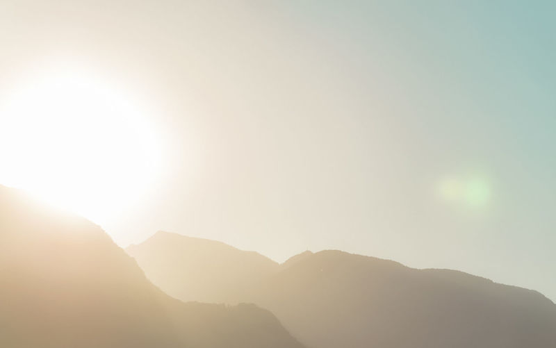 Swiss Alps Sunrise and Mountain Silhouette Mountain Sky Beauty In Nature Mountain Range Tranquility Scenics - Nature Tranquil Scene Nature Sunlight Sun Lens Flare Clear Sky No People Silhouette Mountain Peak Environment Sunbeam Idyllic Day Sunrise Swiss Alps
