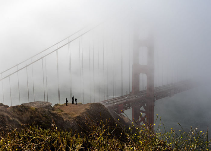 View of suspension bridge in foggy weather