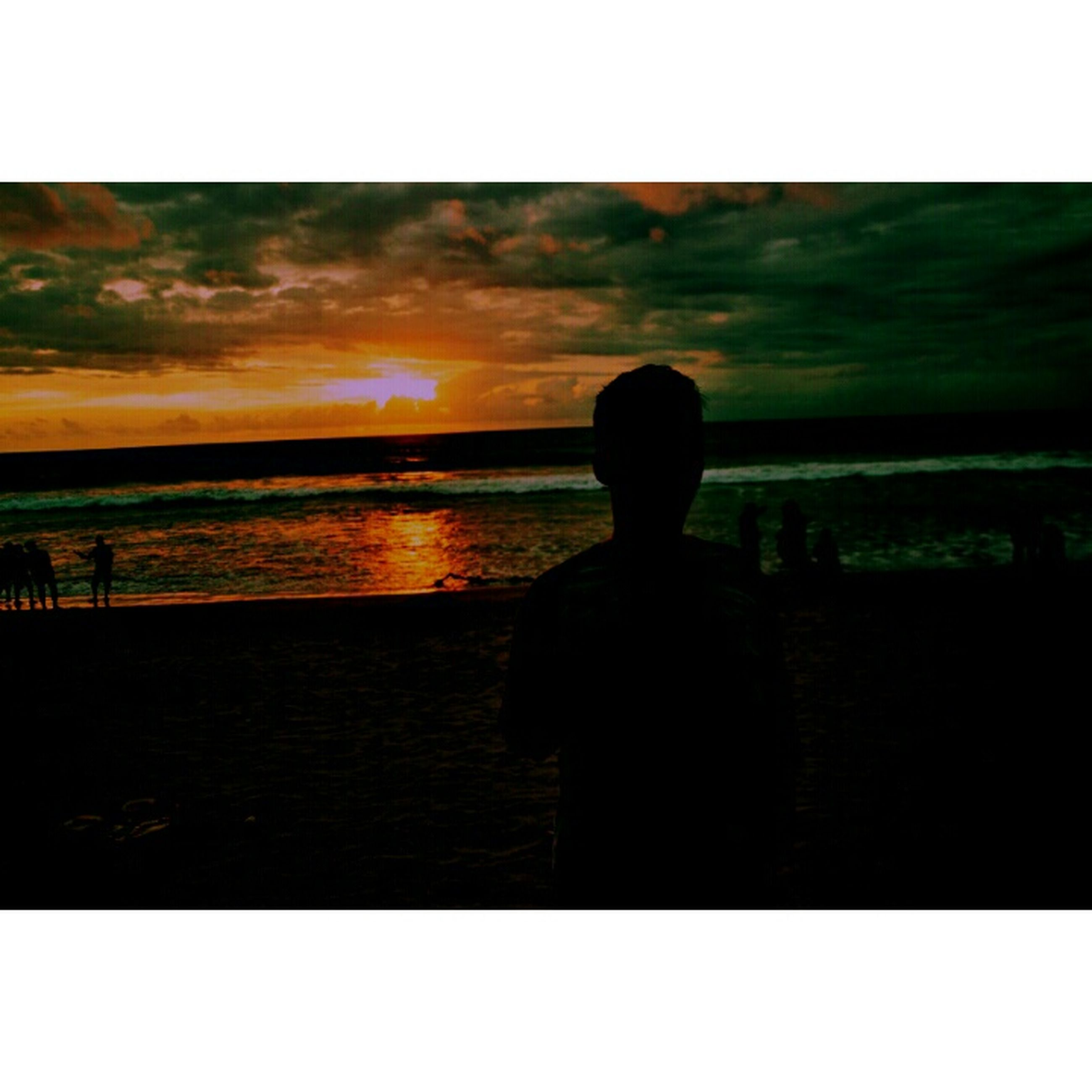 transfer print, sunset, silhouette, auto post production filter, sky, water, sea, standing, lifestyles, horizon over water, men, rear view, tranquil scene, scenics, tranquility, leisure activity, beauty in nature, cloud - sky