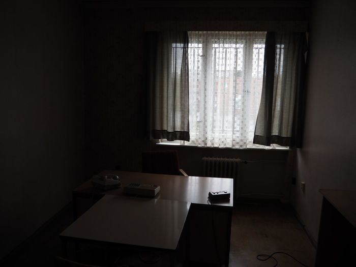 Curtains at window in room at prison