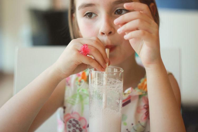 Close-Up Of Girl Drinking A Milkshake