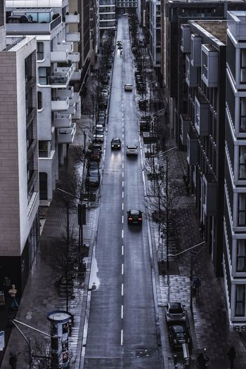 Street City Architecture High Angle View Building Exterior Transportation Built Structure Street Motor Vehicle Road Car City Street Outdoors Building Rain Land Vehicle Wet