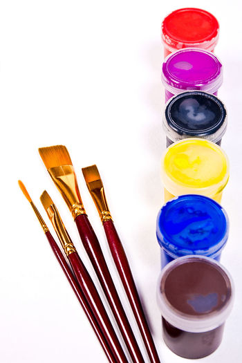 Art And Craft Art And Craft Equipment Brush Choice Close-up Container Creativity Directly Above Group Of Objects High Angle View Indoors  Medium Group Of Objects Multi Colored No People Paintbrush Purple Still Life Studio Shot Table Variation Watercolor Paints White Background