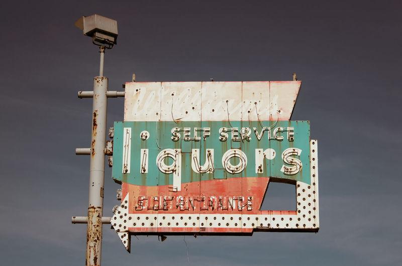 Information sign against sky