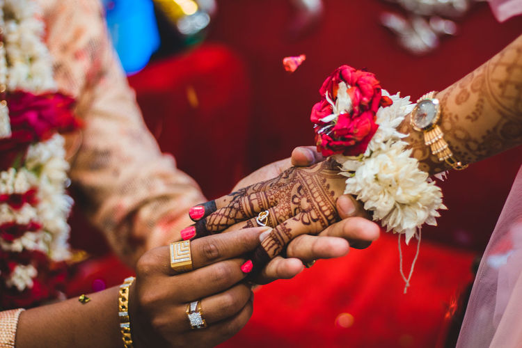 Women Real People Human Hand Midsection Holding Adult Hand Human Body Part Newlywed Ceremony Focus On Foreground Two People Lifestyles Red Celebration Bride Wedding Wedding Ceremony People Ring Couple - Relationship Springtime Decadence The Photojournalist - 2019 EyeEm Awards