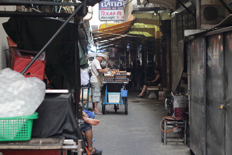 Rear view of people at market stall in city