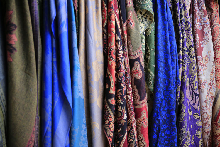 Full frame shot of clothes hanging in market