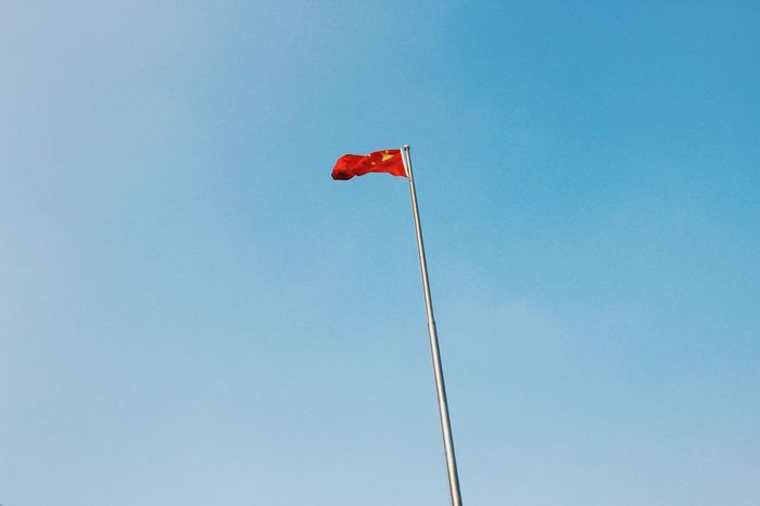 the Chinese national flag. Red Low Angle View Flag Blue Clear Sky No People Sky Day Wind Chinese Chinese Flag National Flag China Photos China