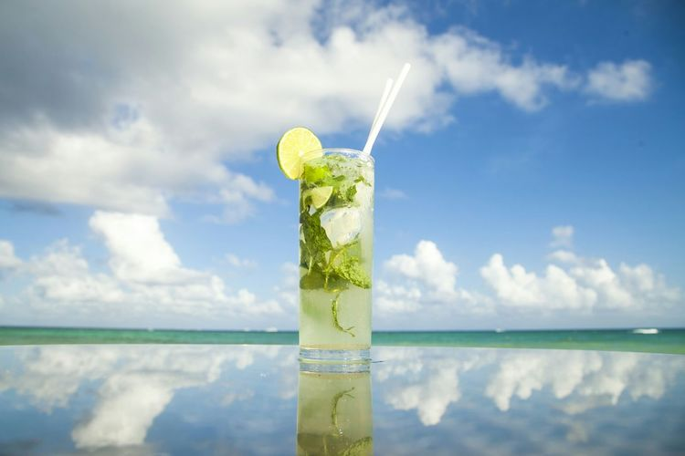 Mojito Cocktail On Table Against Sky