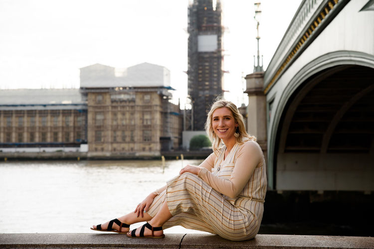 Big Ben Beuatiful Beautfildestinations Beautiful Woman London England Architecture Sitting Built Structure Young Adult Real People One Person Looking At Camera Lifestyles Young Women Full Length Portrait Building Exterior Beauty Casual Clothing Smiling Women Leisure Activity Adult Hair Hairstyle Outdoors