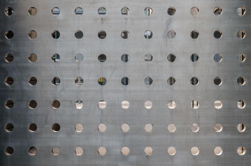 Full frame shot of holes on metallic structure
