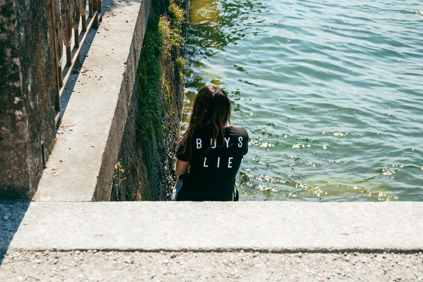 Boys Lie Alone Back Loneliness Lonely Relationship Slogan Stairs Statement Advice Black Tshirt Boys Day Dramatic Fashionable Lifestyles One Person Outdoors Real People Rear View Seaside Sitting Alone Sunny Day This Week On Eyeem Trendy Water