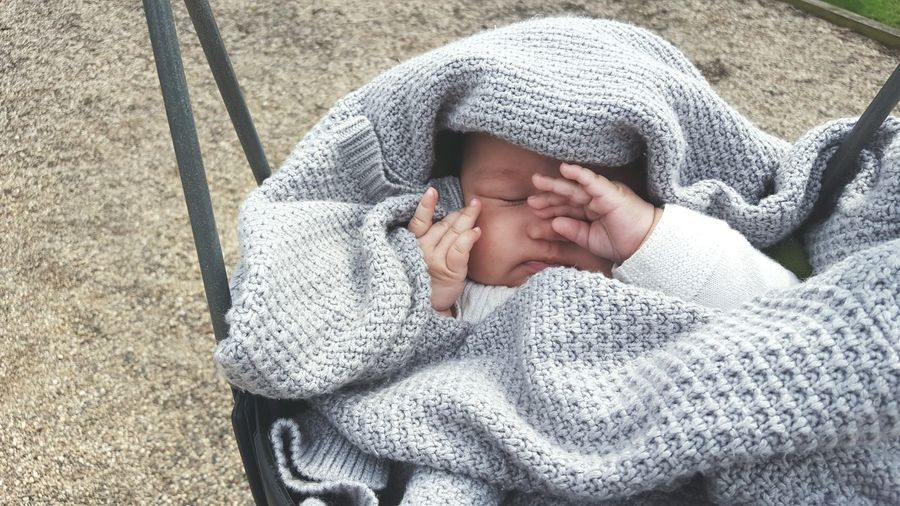 Baby wearing warm clothing in carriage