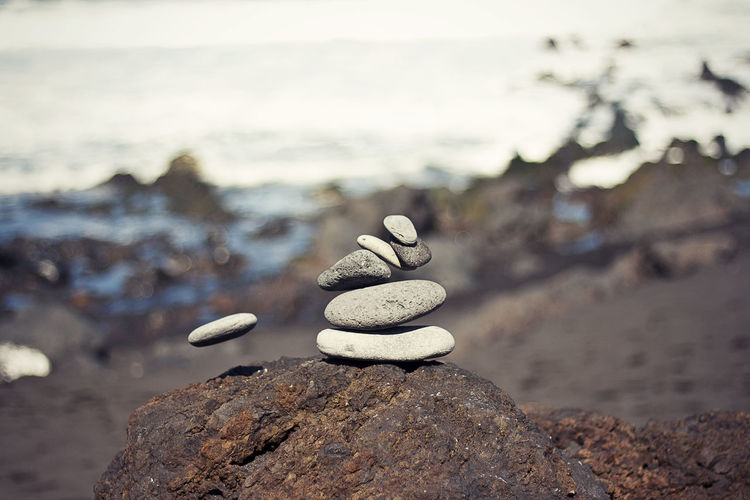 Stacked Stones On Rock At Beach