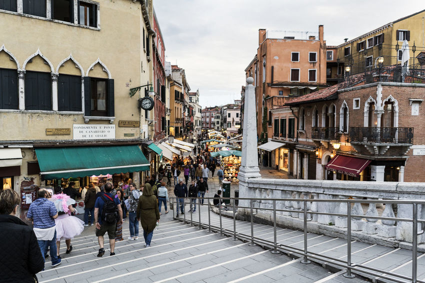 Walking along the narrow streets and canals of Venice, Italy Architecture Building Exterior Built Structure Canal City Day Europe Gondola Italy, Landmarkbuildings Large Group Of People Men Outdoors People Real People Residential Building Sky Travel Destinations Venetian Venice, Italy Walking Women