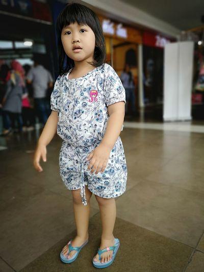 Portrait Of Cute Girl Standing On Floor